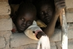 Young boys reach out in Sudan
